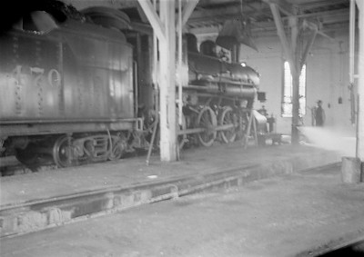 2016.010.FAC1.05569--cole 6x9-8pak neg--C&NW--steam locomotive 4-6-0 R-1 470 inside roundhouse--Winona MN--1930 0821