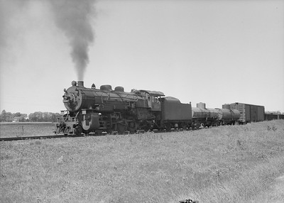 2016.010.FAC2.07376--cole 6x9-8pak neg--C&NW--steam locomotive 2-8-2 J-S 2416 with freight train action--Havana MN--1950 0630