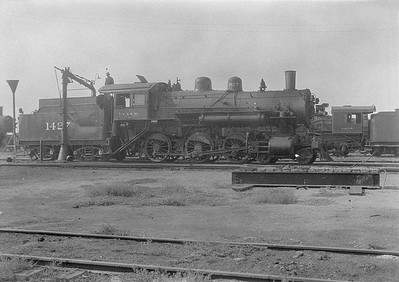 2016.010.FAC1.06194--cole 6x9-8pak neg--C&NW--steam locomotive 4-6-0 R-1 1427 taking water--Chadron NE--1931 0805