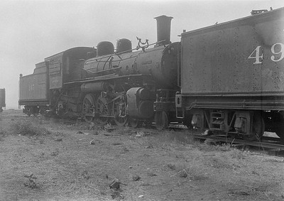 2016.010.FAC1.06189--cole 6x9-8pak neg--C&NW--steam locomotive 4-6-2 147 (dead)--Chadron NE--1931 0805