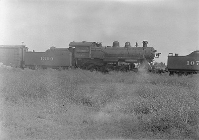 2016.010.FAC1.06111--cole 6x9-8pak neg--C&NW--steam locomotive 4-6-0 R-1 1390 (dead)--Huron SD--1931 0803