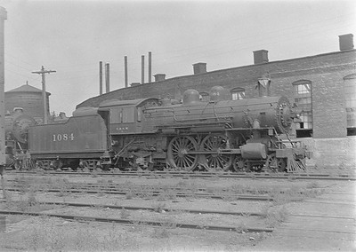 2016.010.FAC1.06117--cole 6x9-8pak neg--C&NW--steam locomotive 4-4-2 D 1084 (dead)--Huron SD--1931 0803