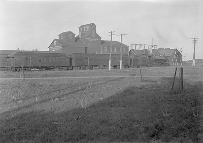 2016.010.FAC1.06110--cole 6x9-8pak neg--C&NW--steam locomotive 4-6-2 E 1566 on passenger train scene--Brookings SD--1931 0803
