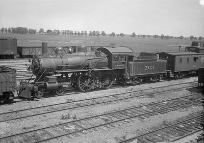 2016.010.FAC1.01819--cole 500 neg--C&NW--steam locomotive B 4-4-0 203 (dead) with caboose yard scene--Janesville WI--1930 0531