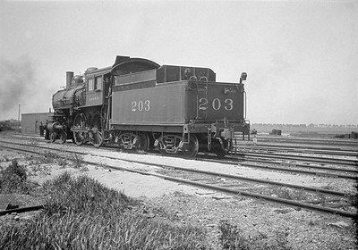 2016.010.FAC1.01824--cole 500 neg--C&NW--steam locomotive B 4-4-0 203 (dead) yard scene--Janesville WI--1930 0531
