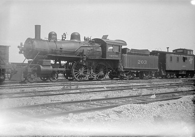 2016.010.FAC1.01818--cole 500 neg--C&NW--steam locomotive B 4-4-0 203 (dead) with caboose--Janesville WI--1930 0531