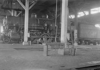 2016.010.FAC1.05426--cole 6x9-8pak neg--C&NW--steam locomotive 4-6-0 R-1 1120 inside roundhouse--Madison WI--1930 0818