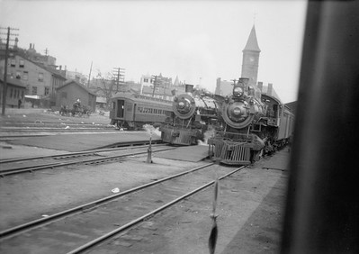 2016.010.FAC1.00611--cole 6x9-8pak neg [Roy W Carlson]--C&NW--steam locomotive 4-4-2 D 1101 and 4-6-2 E 1548 at passenger station scene--Milwaukee WI--no date