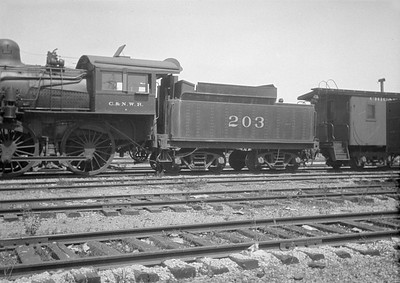 2016.010.FAC1.01817B--cole 500 neg--C&NW--steam locomotive B 4-4-0 203 (dead)--Janesville WI--1930 0531