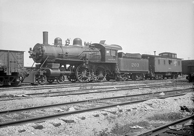 2016.010.FAC1.01820--cole 500 neg--C&NW--steam locomotive B 4-4-0 203 (dead) with caboose--Janesville WI--1930 0531