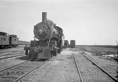 2016.010.FAC1.01822--cole 500 neg--C&NW--steam locomotive B 4-4-0 203 (dead) yard scene--Janesville WI--1930 0531