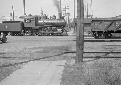 2016.010.FAC1.05423--cole 6x9-8pak neg--C&NW--steam locomotive 0-6-0 M-1 63 street scene--Madison WI--1930 0818