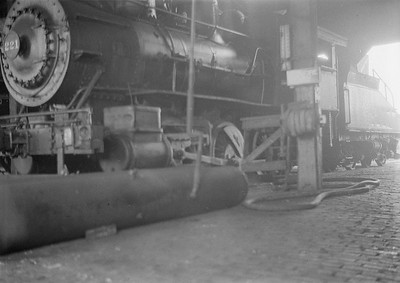 2016.010.FAC1.05443--cole 6x9-8pak neg--C&NW--steam locomotive 0-6-0 M 221 inside roundhouse--North Fond du Lac WI--1930 0818