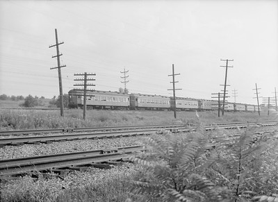2016.010.FAC5.06582--cole 6x9-12pak neg--CA&E--electric interurban train action--Glen Ellyn IL--1945 0722