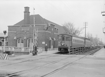 2016.010.FAC5.06599A--cole 6x9-12pak neg--CA&E--electric interurban train making station stop at depot--Wheaton IL--1957 0331