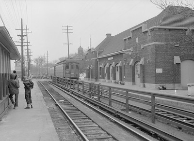 2016.010.FAC5.06599B--cole 6x9-12pak neg--CA&E--electric interurban train at depot--Wheaton IL--1957 0331