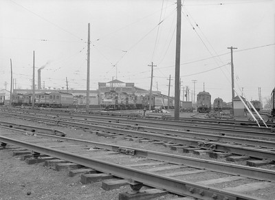 2016.010.FAC5.06599C--cole 6x9-12pak neg--CA&E--shops and yard scene--Wheaton IL--1957 0331