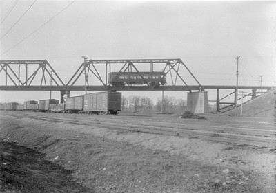 2016.010.FAC5.05938--cole 6x9-12pak neg--CA&E--electric interurban crossing bridge over EJ&E scene--West Chicago IL--1931 0405