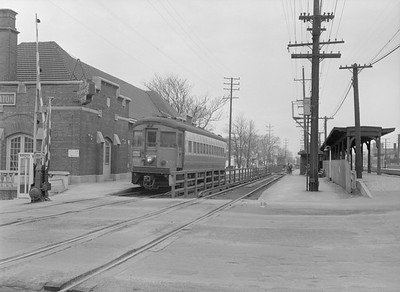 2016.010.FAC5.06599E--cole 6x9-12pak neg--CA&E--electric interurban train at depot--Wheaton IL--1957 0331