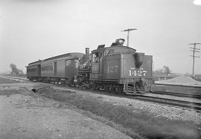2016.010.FAC5.01757--cole 6x9-12pak neg--ICRR--steam locomotive 2-4-6T 1427 rear tender view on Addison commuter passenger train--Chicago IL (North Ave)--1930 0503