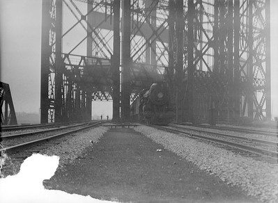 2016.010.FAC5.02083--cole 3x4 neg--NYC--steam locomotive on passenger train crossing large drawbridge--South Chicago IL--1921 0722