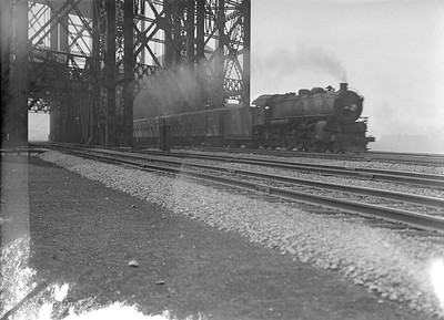 2016.010.FAC5.02084--cole 3x4 neg--NYC--steam locomotive 4-6-2 on passenger train crossing large drawbridge action--South Chicago IL--1921 0722