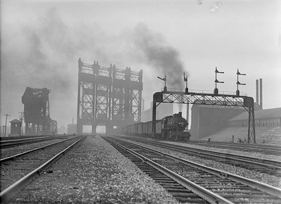 2016.010.FAC5.02081--cole 3x4 neg--NYC--steam locomotive on freight train crossing large drawbridge action--South Chicago IL--1921 0722