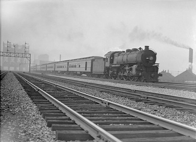 2016.010.FAC5.02079--cole 3x4 neg--NYC--steam locomotive 4-6-2 on passenger train crossing large drawbridge--South Chicago IL--1921 0722