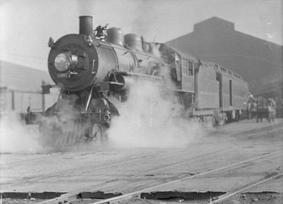 2016.010.FAC5.05000--cole 6x9-12pak neg--MC--steam locomotive 4-4-2 8087 on passenger train at station--Grand Rapids MI--1916 0711