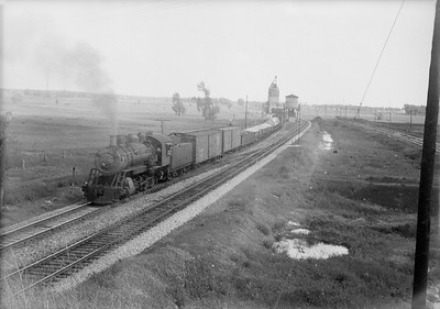 2016.010.FAC5.06479--cole 6x9-12pak neg--EJ&E--steam locomotive 2-8-0 600 on freight train scene--2 miles north of West Chicago IL--1937 0531