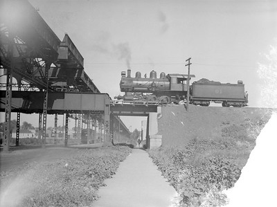 2016.010.FAC5.02074--cole 3x4 neg--BRC--steam locomotive 0-6-0 61 on elevated right-of-way scene (Lake and 46th St)--Chicago IL--1921 0720