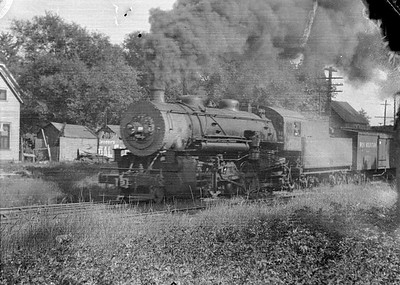 2016.010.FAC5.05212--cole 6x9-12pak neg--IHB--steam locomotive 2-8-2 259 on freight train action--Congress Park IL--1919 0600