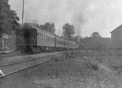2016.010.FAC5.05185--cole 6x9-12pak neg--PM--steam locomotive 4-4-2 380 on passenger train action--Newaygo MI--1919 0620