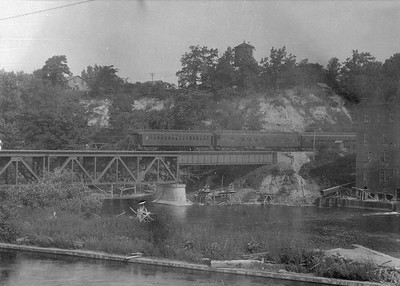 2016.010.FAC5.05191--cole 6x9-12pak neg--PM--steam locomotive 4-4-2 381 on passenger train crossing Muskegon River--Newayago MI--1919 0620