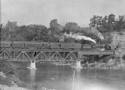 2016.010.FAC5.05186--cole 6x9-12pak neg--PM--steam locomotive 4-4-2 381 on passenger train crossing Muskegon River--Newayago MI--1919 0620