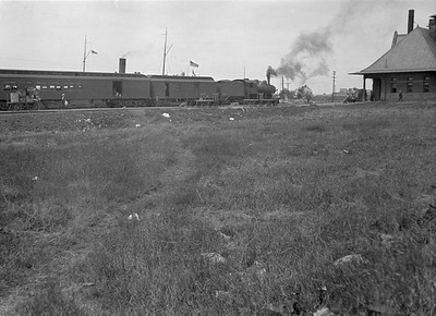 2016.010.FAC5.06701--cole 6x9-12pak neg--PM--steam locomotive 4-6-0 152 on passenger train making station stop--Muskegon MI--no date