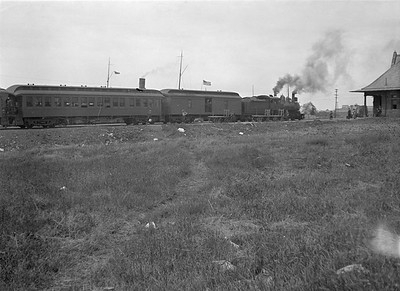 2016.010.FAC5.01030--cole 6x9-12pak neg--PM--steam locomotive 4-6-0 152 on passenger train making station stop--Muskegon MI--no date