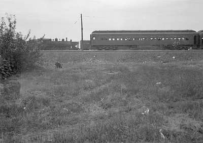 2016.010.FAC5.01032--cole 6x9-12pak neg--PM--steam locomotive 0-6-0 412 yard scene with with passenger train making station stop--Muskegon MI--no date