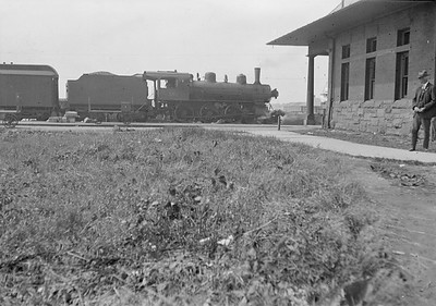 2016.010.FAC5.01031--cole 6x9-12pak neg--PM--steam locomotive 4-6-0 152 on passenger train making station stop--Muskegon MI--no date