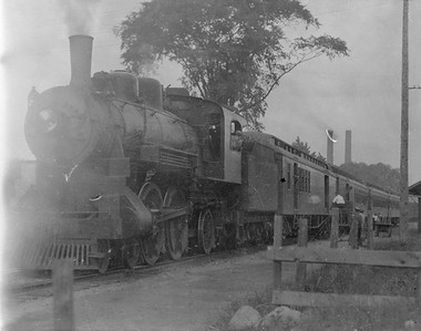 2016.010.FAC5.05181--cole 6x9-12pak neg--PM--steam locomotive 4-4-2 380 on passenger train at station platform--Newayago MI--1919 0618