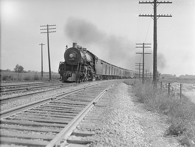 2016.010.FAC5.02105--cole 3x4 neg--AT&SF--steam locomotive on passenger train action--McCook IL--1921 0821