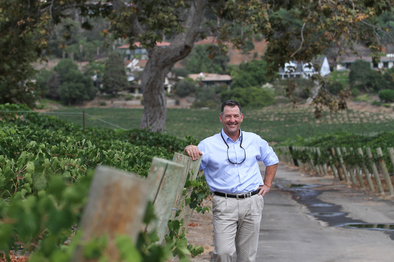 Jade Work, owner and developer of Monserate Winery, stands among a variety of Italian grape vines planted in Fallbrook's Gird Valley.  Shane Gibson photos