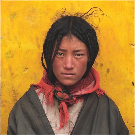 Tibet - girl yellow wall