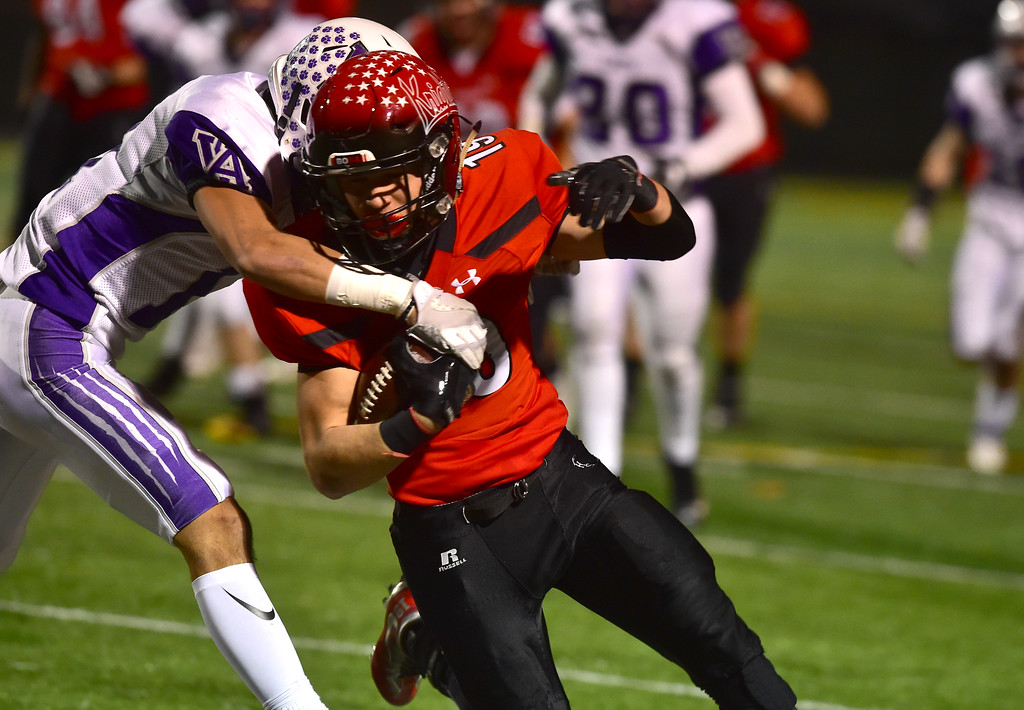 . Fairview High School\'s Bryce DesJardins fights for extra yardage as Arvada West\'s Orie Gorse tries to bring him down during their game at Recht Field in Boulder. For more photos go to bocopreps.com Paul Aiken Staff Photographer Nov 10 2017