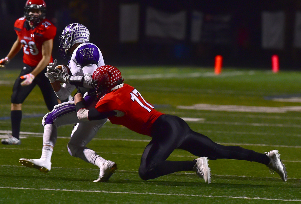. Fairview High School\'s Jeffery Erickson brings down Arvada West\'s Tony Cass during their game at Recht Field in Boulder. For more photos go to bocopreps.com Paul Aiken Staff Photographer Nov 10 2017