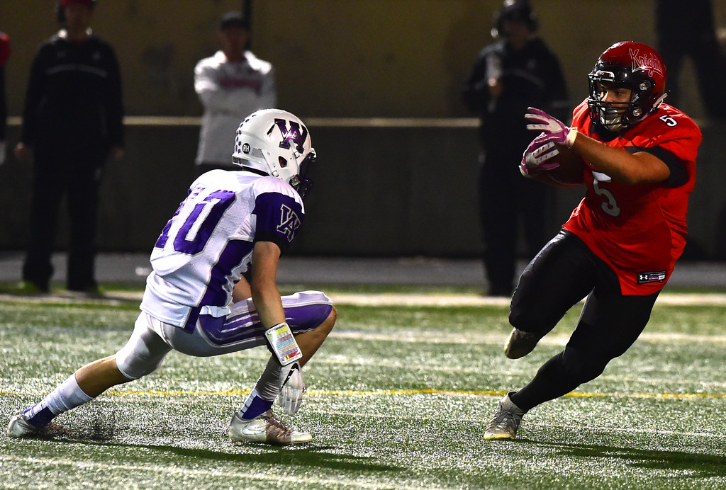 . Fairview High School\'s Mariano Kemp evades Arvada West\'s Dale Winter during their game at Recht Field in Boulder. For more photos go to bocopreps.com Paul Aiken Staff Photographer Nov 10 2017