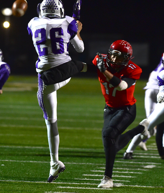 . Fairview High School\'s Jeffery Erickson blocks a punt by Arvada West\'s Liam Spaw during their game at Recht Field in Boulder. For more photos go to bocopreps.com Paul Aiken Staff Photographer Nov 10 2017