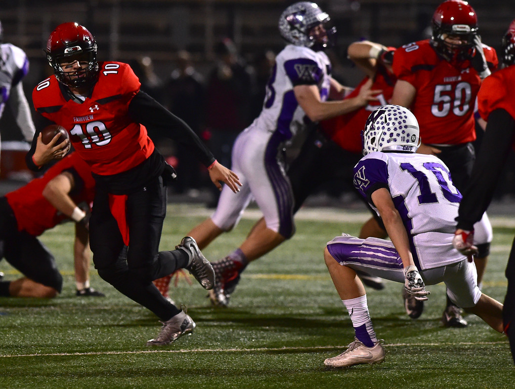 . Fairview High School\'s quarterback Aikdan Atkinson gets away from Arvada West\'s Dale Winter during their game at Recht Field in Boulder. For more photos go to bocopreps.com Paul Aiken Staff Photographer Nov 10 2017