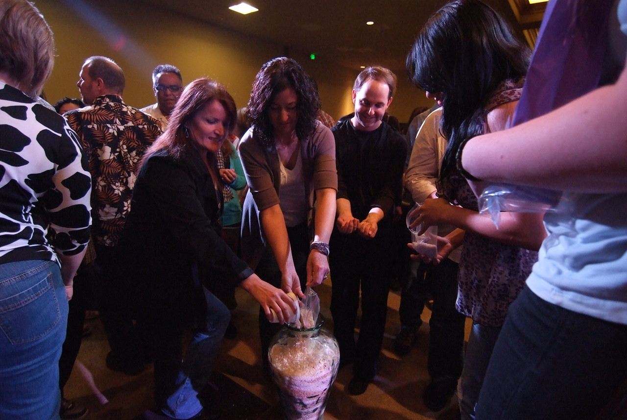 "Pouring fresh rice in our vase for the ""Rice on the altar"""