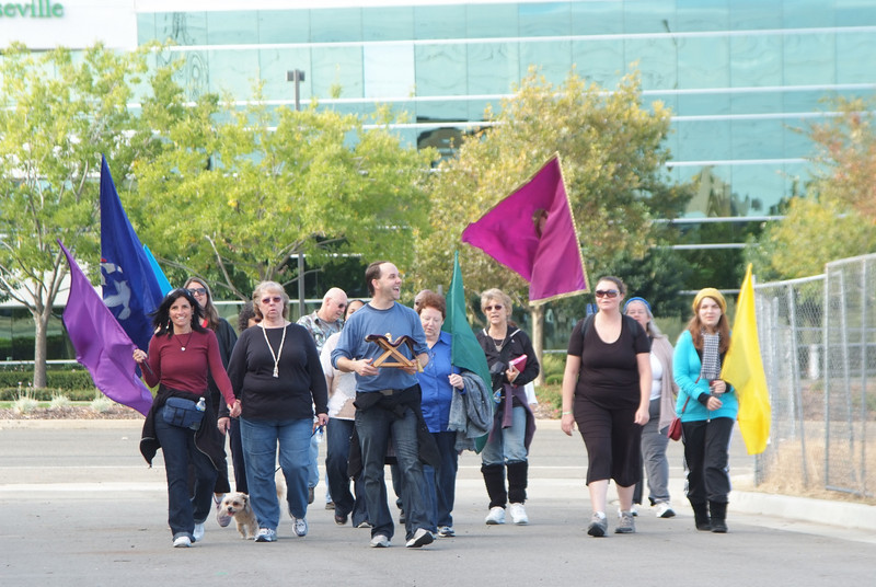 """Worship Walkers walked 6.4 miles from the old church campus to our new campus, ushering in the Word, carrying a replica of the Ark of the Covenant, reading the word all the way! They placed stones with the Word of God on them along the path and in the creek as we """"crossed over"""" to the new land of promise, Roseville!"""